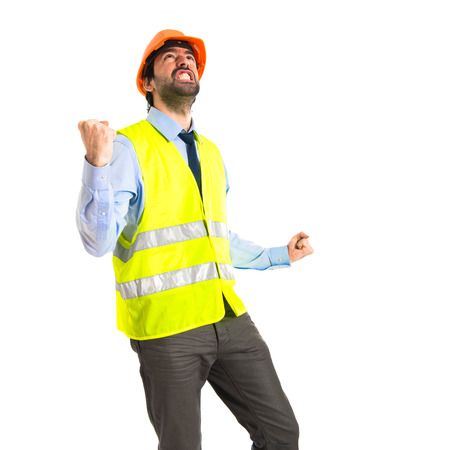 workman doing victory gesture