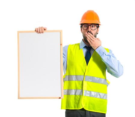 Workman holding empty placard photo