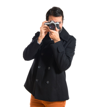 Handsome man photographing something photo