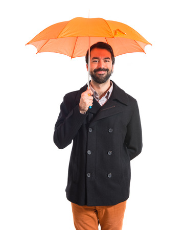 Man holding an umbrella over white background photo