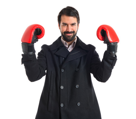 Brunette man with boxing gloves photo