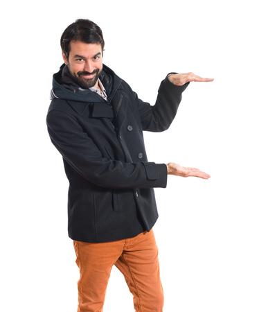 Man holding something over white  photo