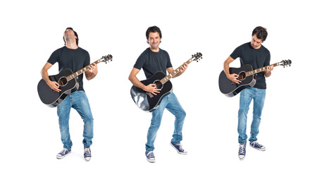 guy playing guitar: Handsome man with guitar over white background