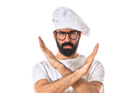 nonverbal communication: Chef doing NO gesture over white background