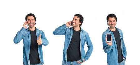 Handsome man talking to mobile over white background photo