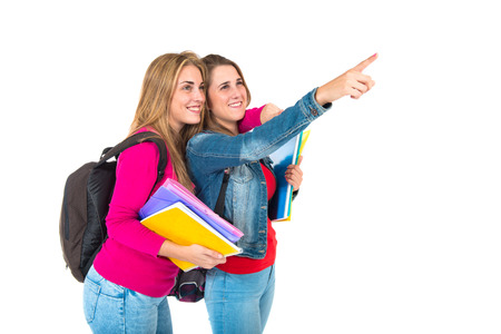 Student women pointing to the lateral over white background photo