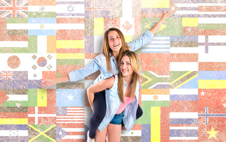 Friends playing over flags background photo