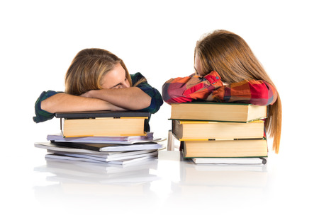 Tired students over white background photo