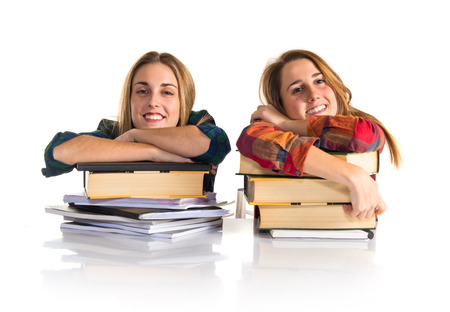 Happy friends studying together photo
