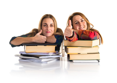 Friends with thumb up while studying together photo