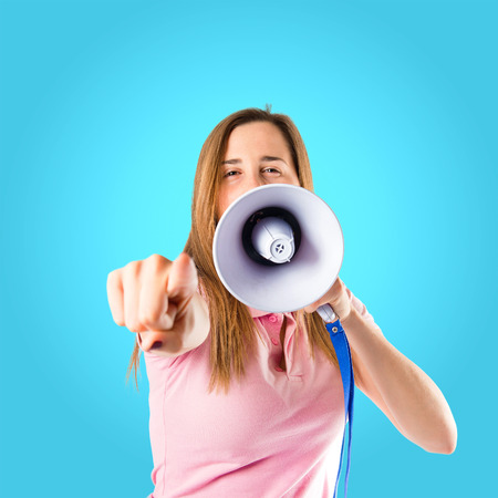 Girl shouting over blue background photo