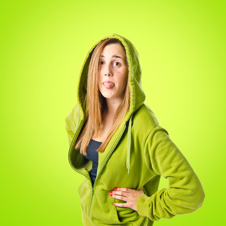 Young girl doing a joke over green white background photo