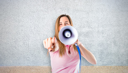 Girl shouting over textured background photo
