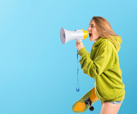 young teen girl: Girl shouting over blue background Stock Photo