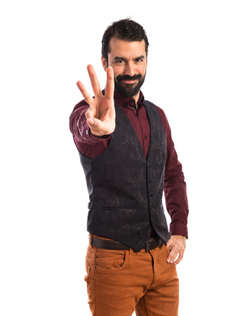 waistcoat: Man wearing waistcoat counting three