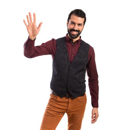 gente saludando: El hombre que llevaba saludando chaleco Foto de archivo