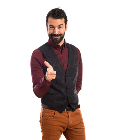 waistcoat: Man wearing waistcoat pointing to the front