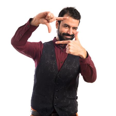 waistcoat: Man wearing waistcoat focusing with his fingers