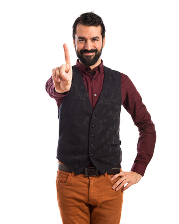 one by one: Man wearing waistcoat counting one