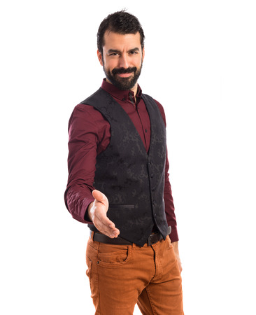 deal making: Man wearing waistcoat making a deal Stock Photo