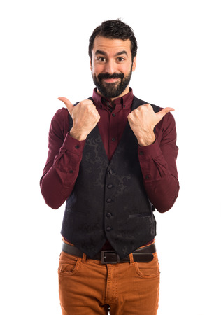 waistcoat: Man wearing waistcoat with thumb up
