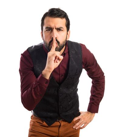 waistcoat: Man wearing waistcoat making silence gesture