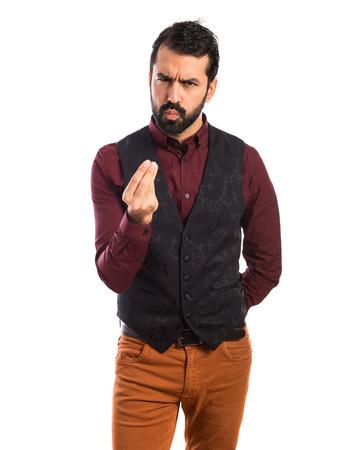 waistcoat: Man wearing waistcoat doing a money gesture Stock Photo