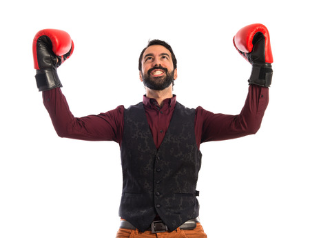 lucky man: Lucky man wearing waistcoat with boxing gloves Stock Photo