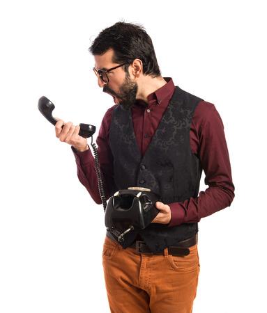 Man wearing waistcoat talking to vintage phone photo