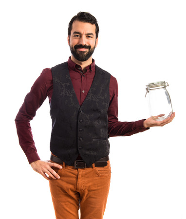 a jar stand: Man wearing waistcoat holding an empty glass jar Stock Photo