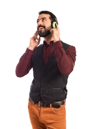 waistcoat: Man wearing waistcoat listening music
