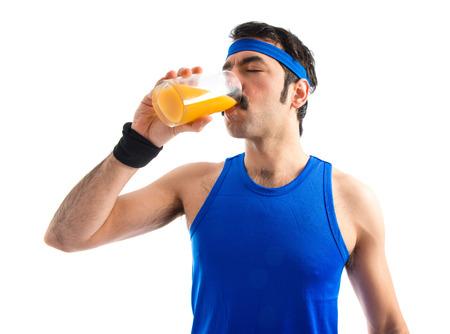 sportman: Sportman drinking orange juice Stock Photo