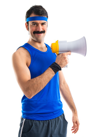 Sportman shouting by megaphone