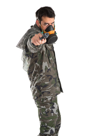 special service agent: Soldier with gas mask shooting a gun Stock Photo