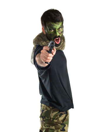 Soldier shooting with a pistol photo