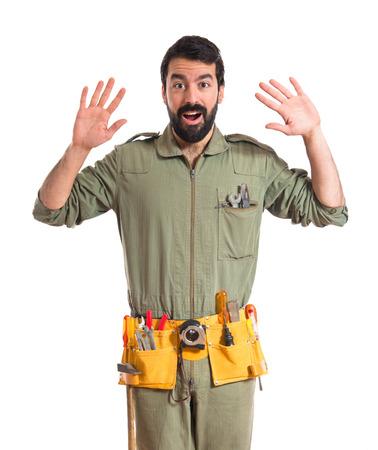 Mechanic doing surprise gesture photo