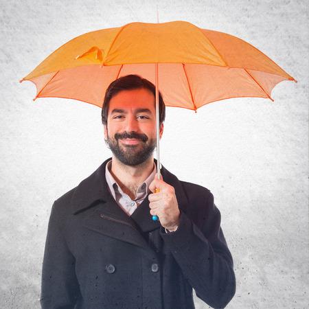 umbrella: Man holding an umbrella over white background
