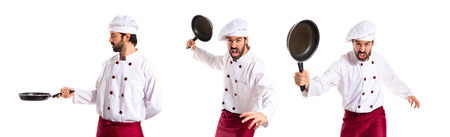 dripping pan: Chef holding frying pan