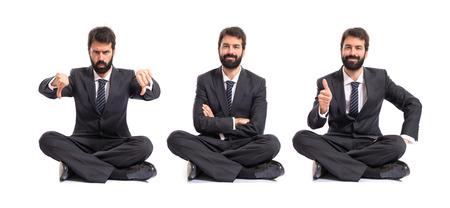 Happy businessman over white background photo