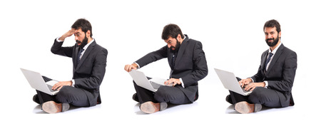 Angry businessman with laptop over white background photo