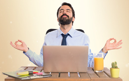 Businessman in his office  in zen position Stock Photo