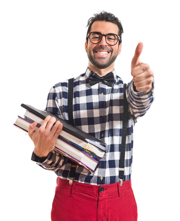 Happy posh boy holding books photo