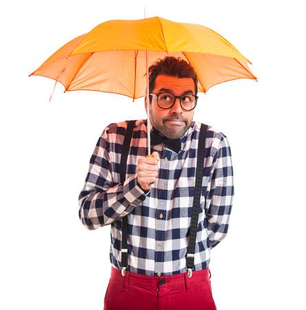 posh: Posh boy holding an umbrella