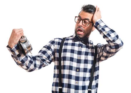 posh: Surprised posh boy holding vintage clock