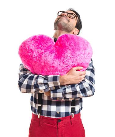 preppy: Posh boy holding a big heart Stock Photo