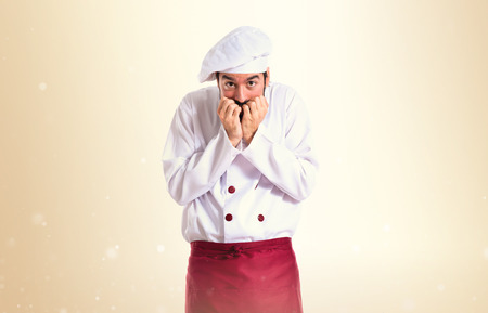 frightened: Frightened chef over white background
