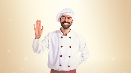 hi hat: Chef saluting over white background