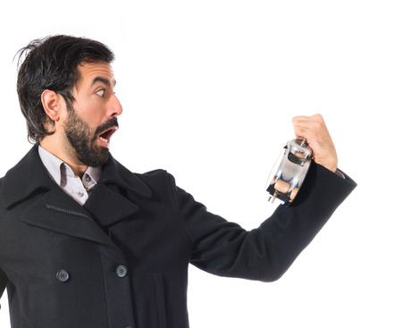 surprised man: Surprised man holding a clock