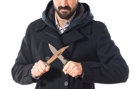 holding a knife: Man holding a knife Stock Photo
