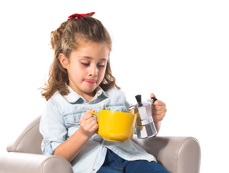 Blonde cute girl holding a cup of tea photo